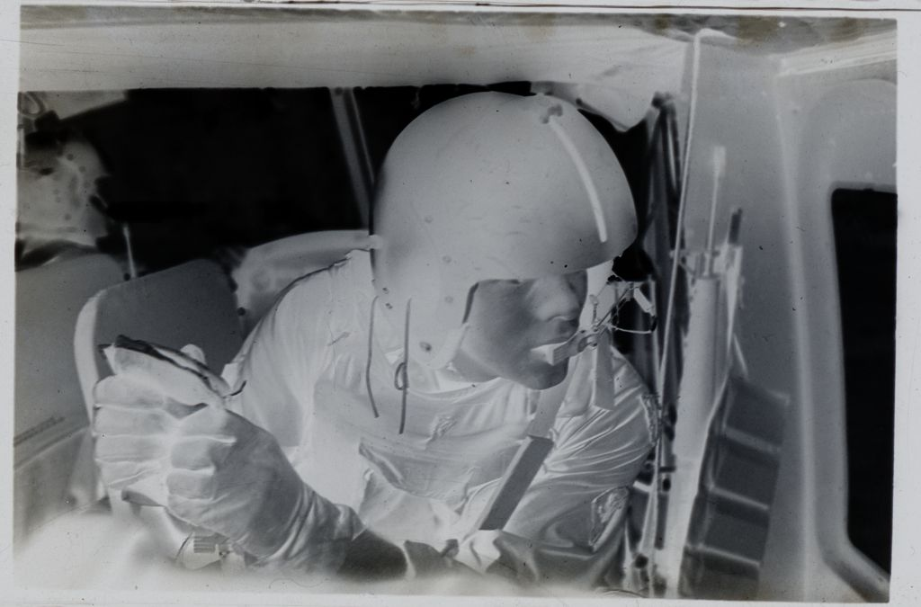 Untitled (Soldier Holding Plasma Bag Inside Medevac Helicopter, Vietnam)
