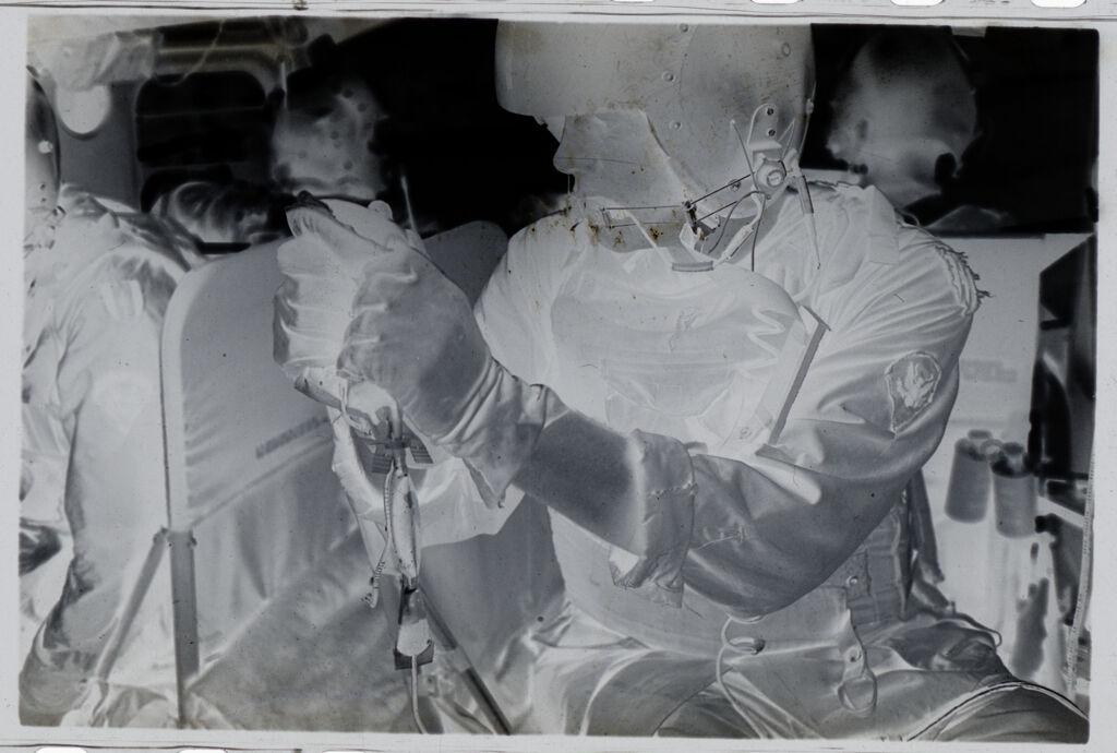 Untitled (Soldier Holding Plasma Bag Inside Medevac Helicopter, Vietnam)