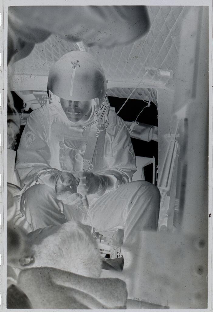 Untitled (Soldier Treating Vietnamese Boy Inside Medevac Helicopter, Vietnam)