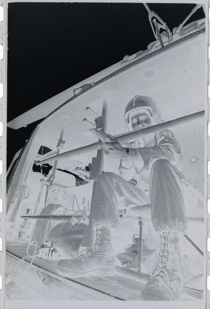 Untitled (Soldier Sitting On Side Of Medevac Helicopter, Vietnam)