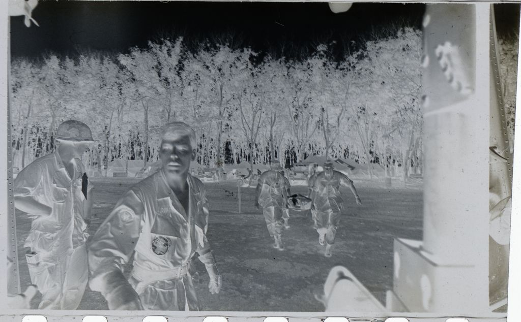 Untitled (Soldiers Carrying Supplies To Helicopter, Vietnam)