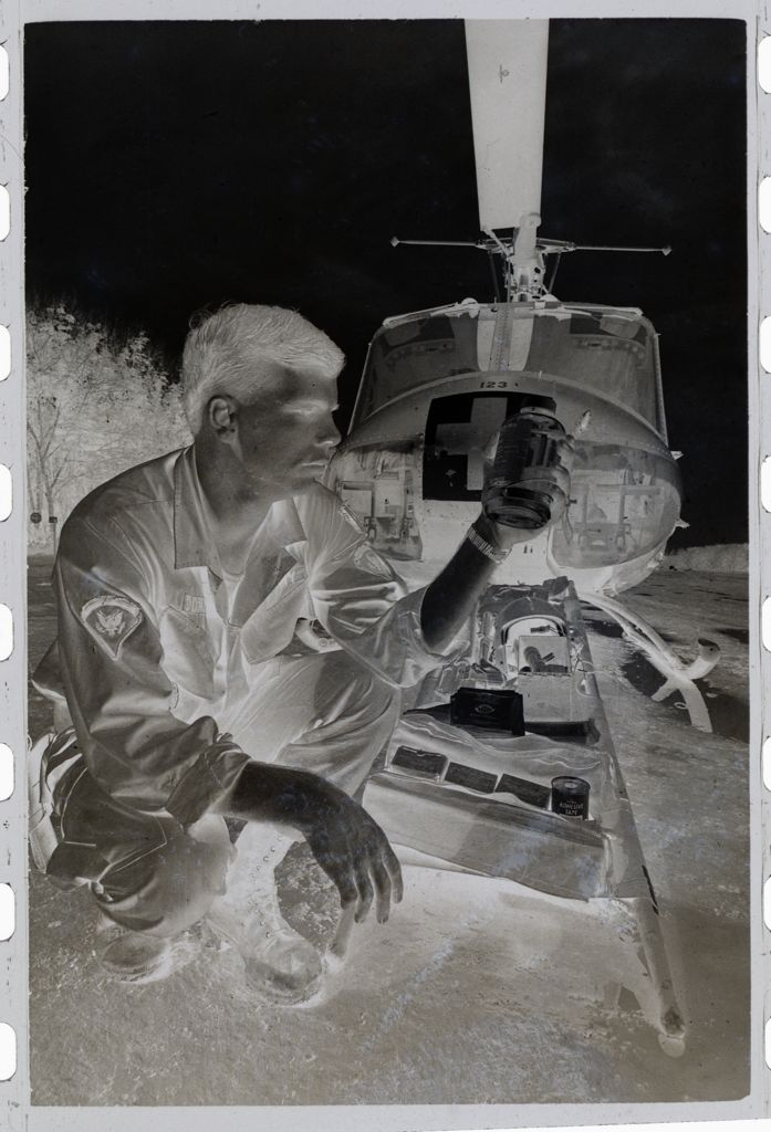 Untitled (Soldier With Supplies And Stretcher In Front Of Medevac Helicopter, Vietnam)