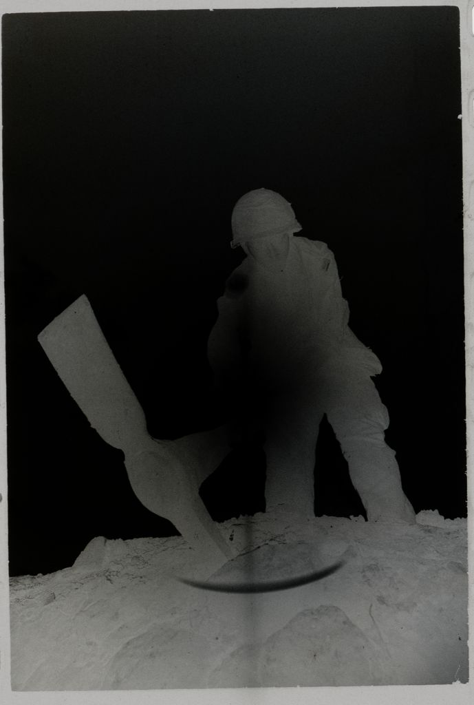 Untitled (Soldier With Pickaxe Silhouetted Against The Sun, Vietnam)