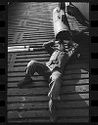 Untitled (Soldier Lying On Back On Deck Looking Into Large Pipe, Vietnam)