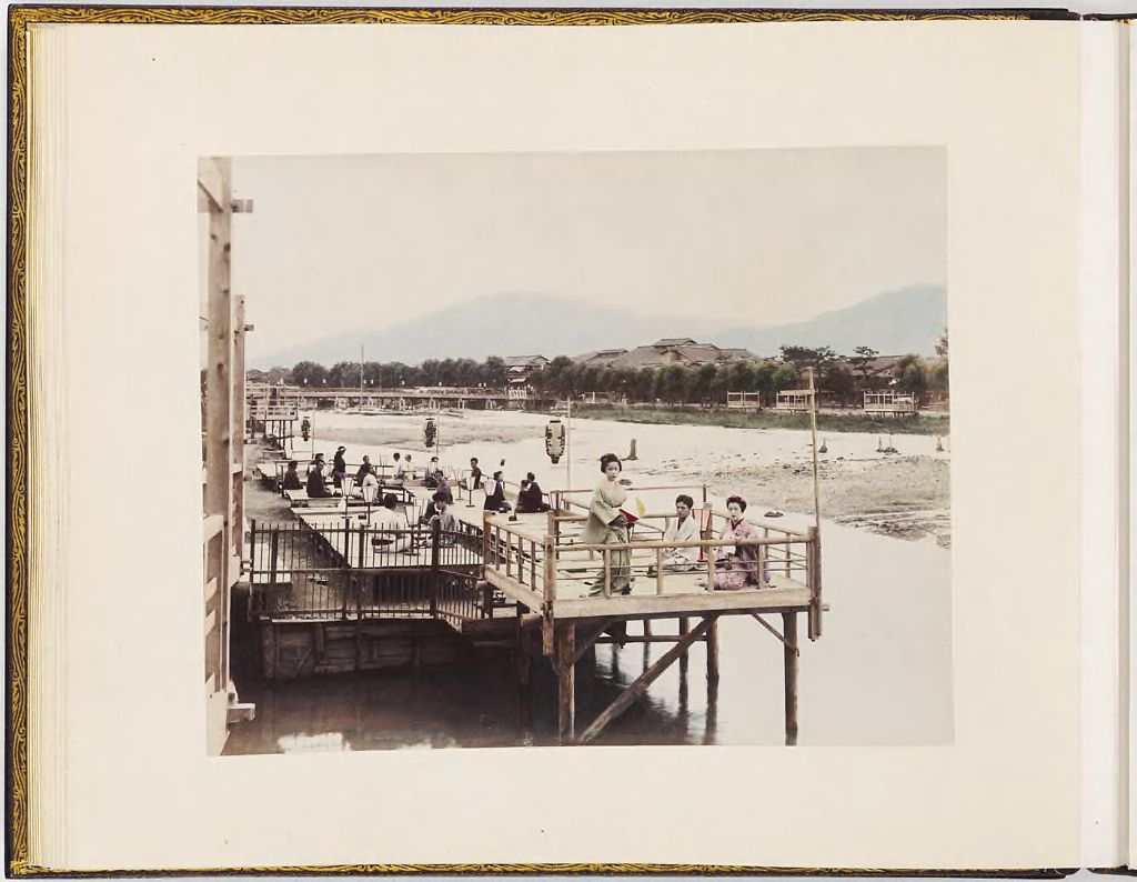 Untitled (Group Of People On Pier, Buildings And Mountains In Background)