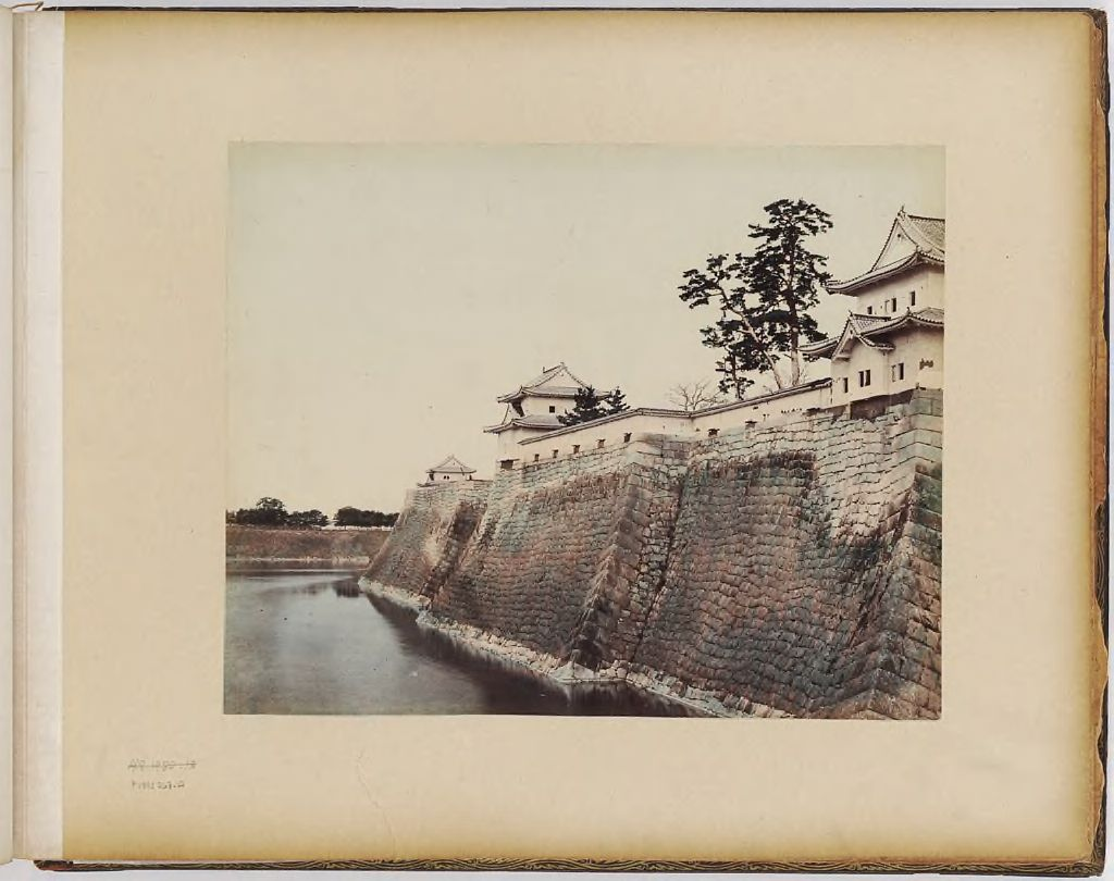Untitled (Buildings On The Bank Of A River)