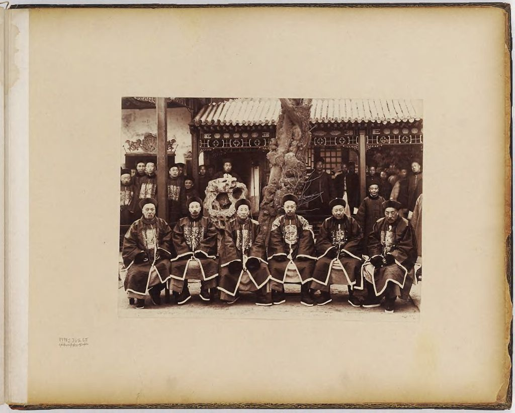 Untitled (Group Of Six Men, Seated, Crowd Of Men In Background)