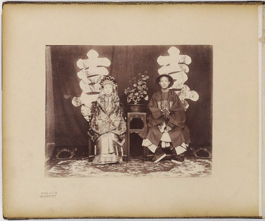 Untitled (Man And Woman Seated Wearing Formal Robes)