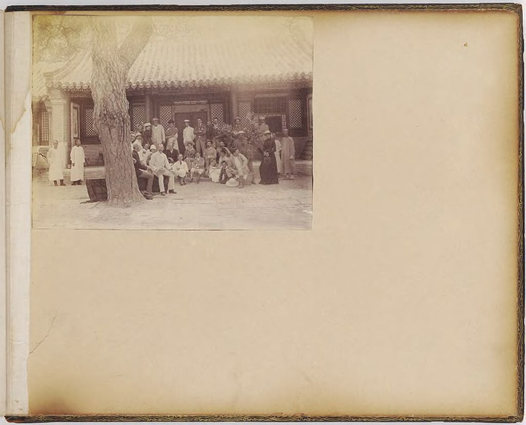 Untitled (Group Of People In Front Of A House)