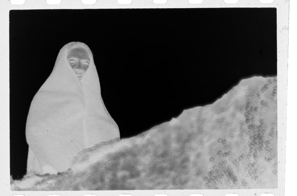 Untitled (Woman Wrapped In Blanket Standing Above Small Ledge, Nazaré, Portugal)