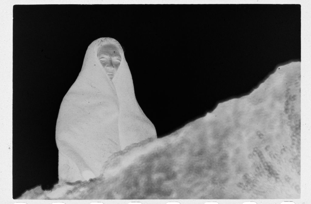Untitled (Female Cowherd Wrapped In Blanket Standing Above Small Ledge, Nazaré, Portugal)