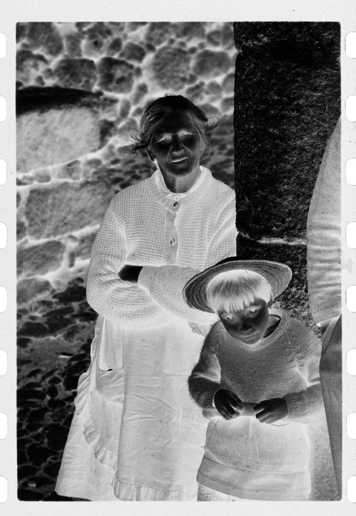 Untitled (Woman And Child Leaning Against Stone Wall, Nazaré, Portugal)
