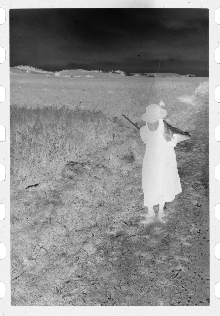 Untitled (Woman Carrying Scythe And Pack Along Road By Field, Nazaré, Portugal)