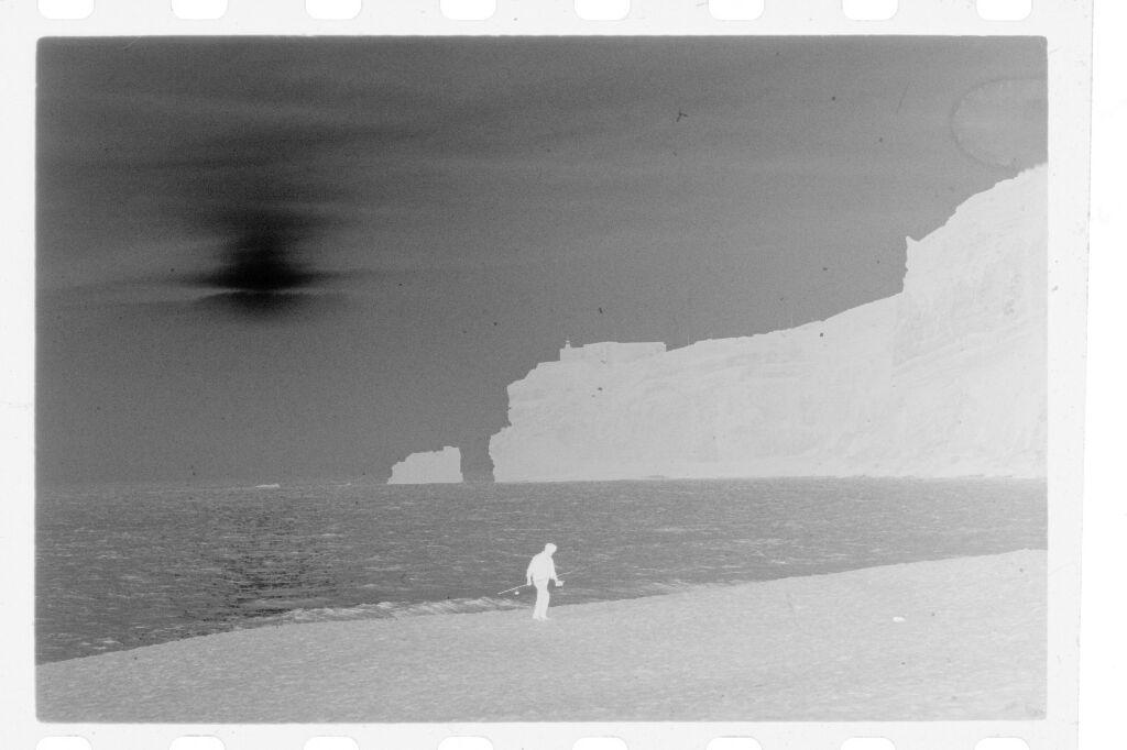 Untitled (Lone Fisherman Walking On Beach, Nazaré, Portugal)