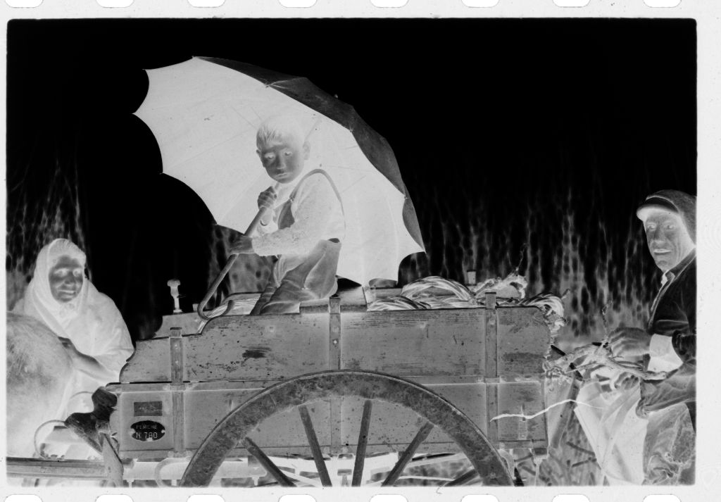 Untitled (Old Woman, Old Man And Boy With Umbrella With Mule-Drawn Cart, Nazaré, Portugal)
