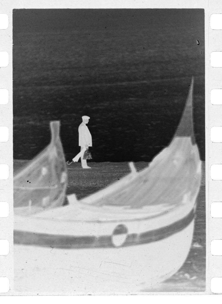 Untitled (Fishing Boats On Beach With Man Walking In The Background, Nazaré, Portugal)