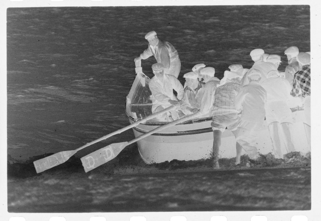 Untitled (Men Pushing Fishing Boat Over Waves And Boarding, Nazaré, Portugal)
