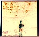 Untitled (Young Boy In Wooded Backyard)