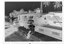 Untitled (Young Girl In Hat Sitting On Ledge In Front Of Boat)