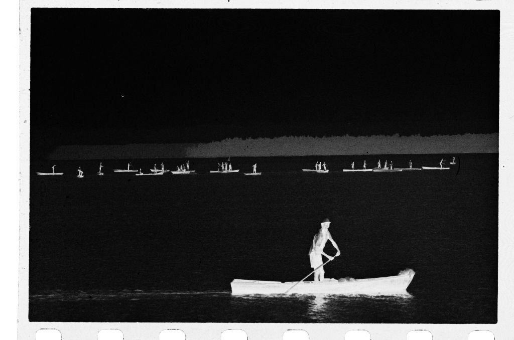 Untitled (View From A Distance Of Boats On Water With Boat And Rower In Foreground)