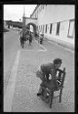 Untitled (Children Carrying Chairs Through Town Square, Nazaré, Portugal)