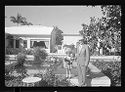 Untitled (Young Girl In Hat Standing On Ledge Next To Man In Suit And Hat)