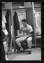 Untitled (Baseball Player Sitting In Front Of Locker)