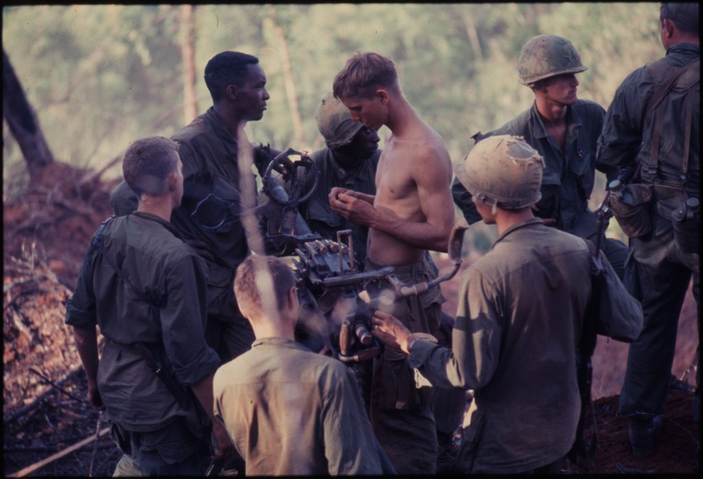 Untitled (Group Of Soldiers Setting Up Weapon In Jungle Of Central Highlands Near Dak To, Vietnam)