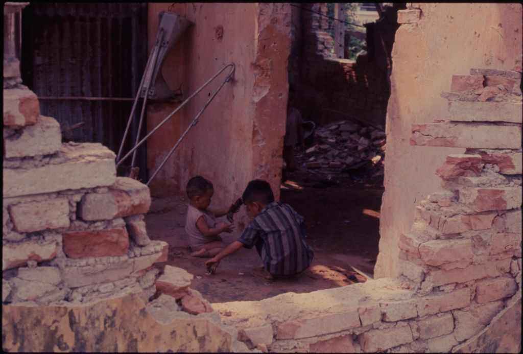 Untitled (Two Young South Vietnamese Boys Playing Inside Damaged Building, Hue, Vietnam)