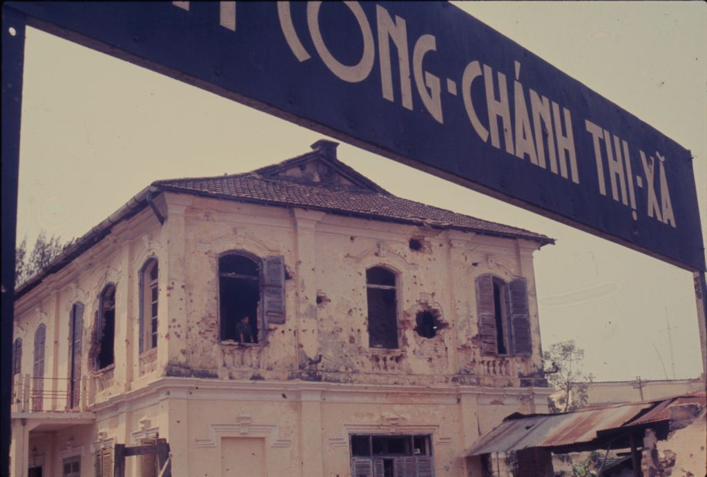 Untitled (Damaged Building Framed By Sign, Hue, Vietnam)