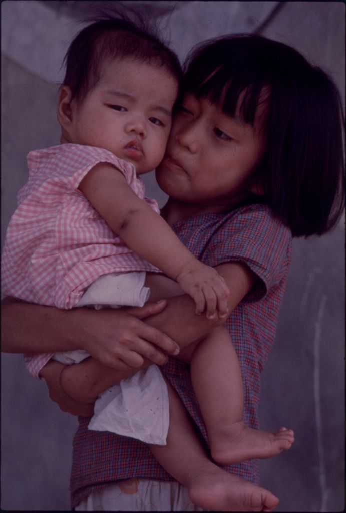 Untitled (Young Girl Holding Baby, Hue, Vietnam)
