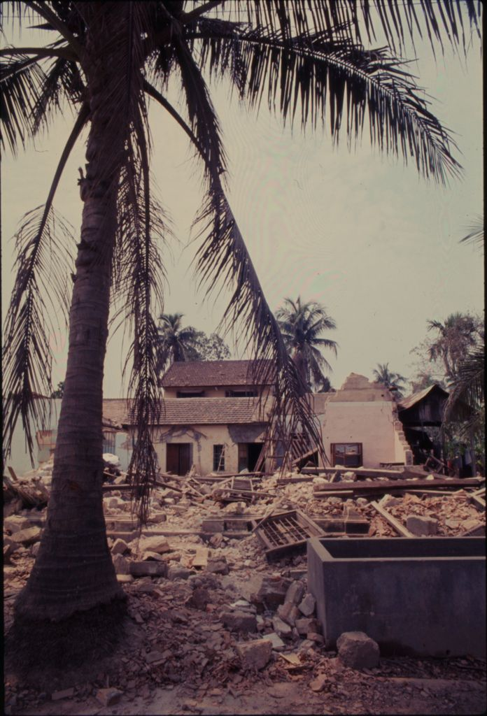 Untitled (Damaged Building With Debris Piled In Front And Palm Tree In Foreground, Hue, Vietnam)