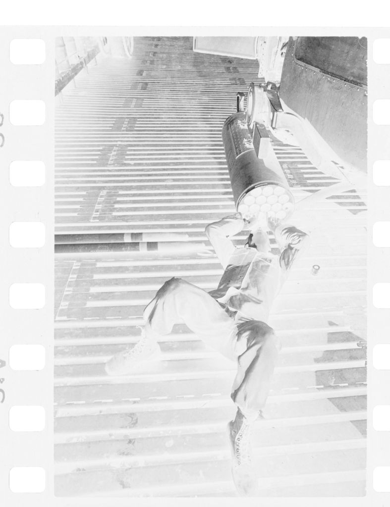 Untitled (Soldier Lying On Back Looking Into Tube, Vietnam)