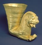 Beaker with the forepart of a crested and winged lion