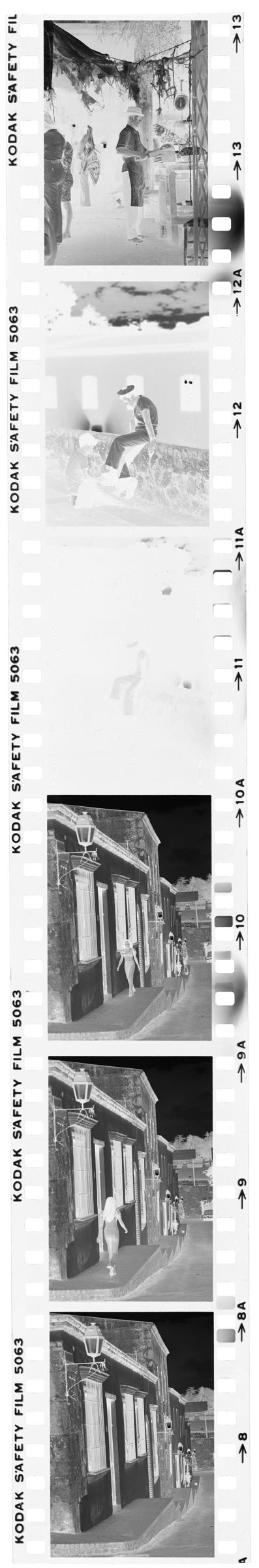 Untitled (Stone Buildings Along Side Of Street; Sailor Sitting On Stone Ledge; Market)