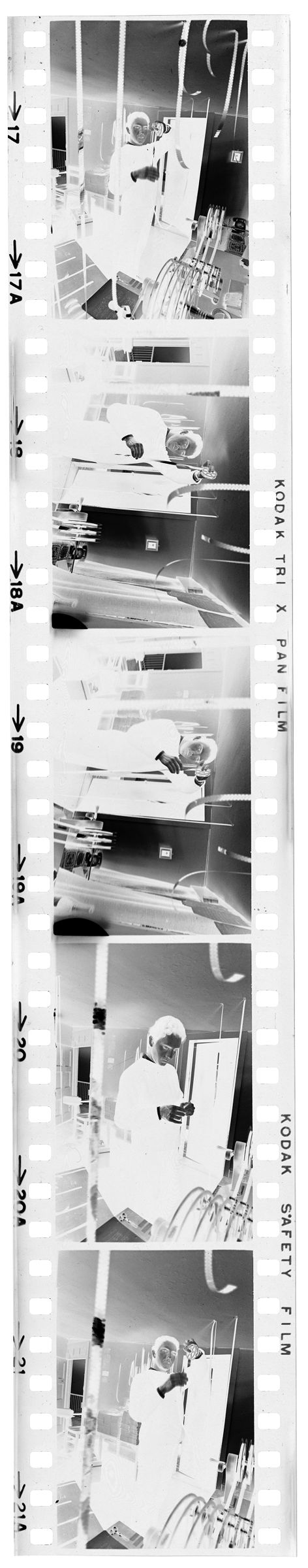 Untitled (Photographer Cutting And Hanging Film)