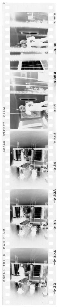 Untitled (Photographer Examining Film)