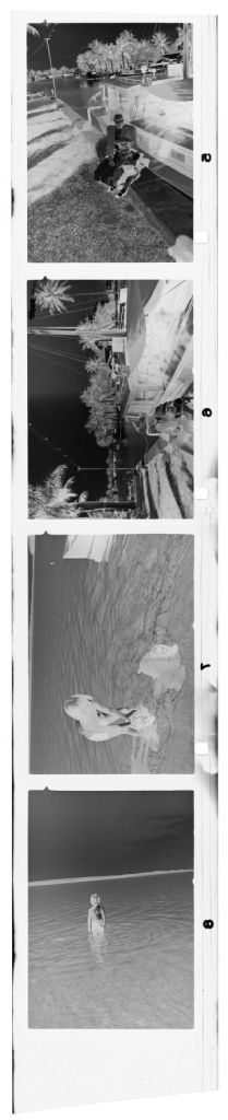 Untitled (Young Girl In Ocean And On Ledge In Front Of Boat)