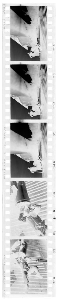 Untitled (Soldiers Working On Helicopters And Parts, Vietnam)