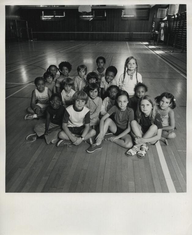 Group portrait of children in a gymnasium