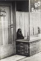 Boy In The Window Of A Beauty Salon; East New York