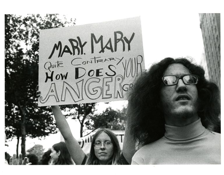 """Woman holding sign reading  """"Mary Mary quite contrary, how does your anger grow"""" at a women's rights rally"""