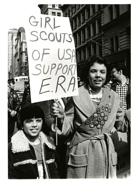 Girl scouts attending International Women's Day march