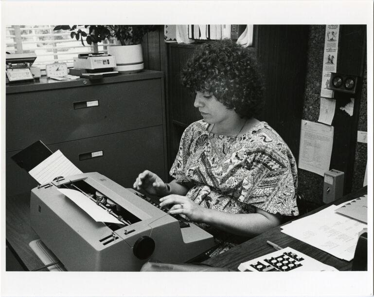 Women at work: pregnant secretary at work