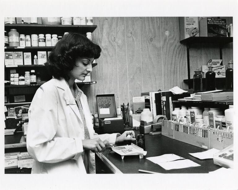 Women at work: pharmacist.