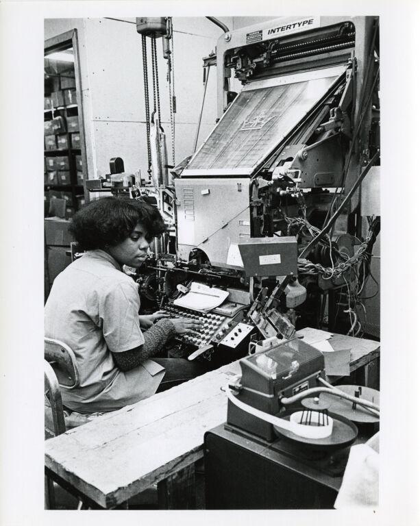 Women at work: typsetter at the linotype machine