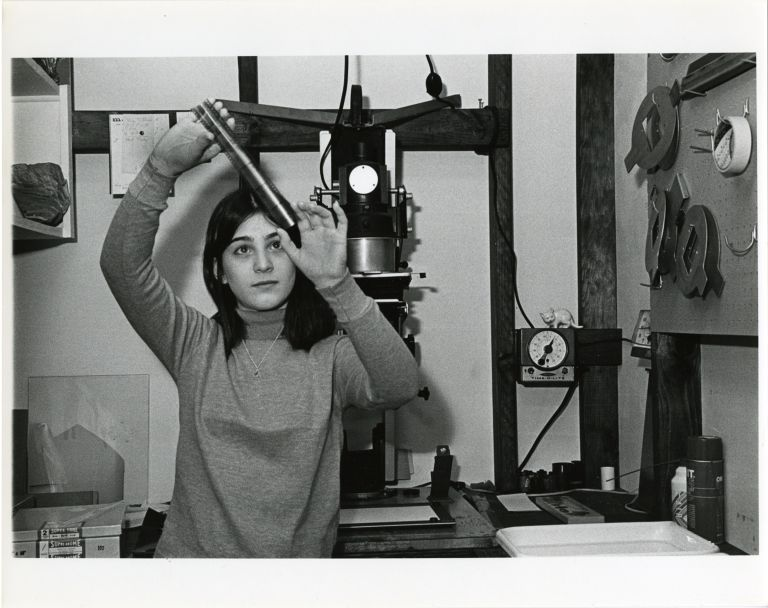 Women at work: teenage photographer working in darkroom.