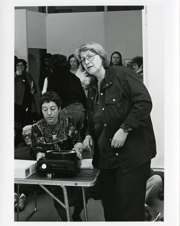 Phyllis Birkby and Gloria Orenstein showing slides at the Woman's Salon