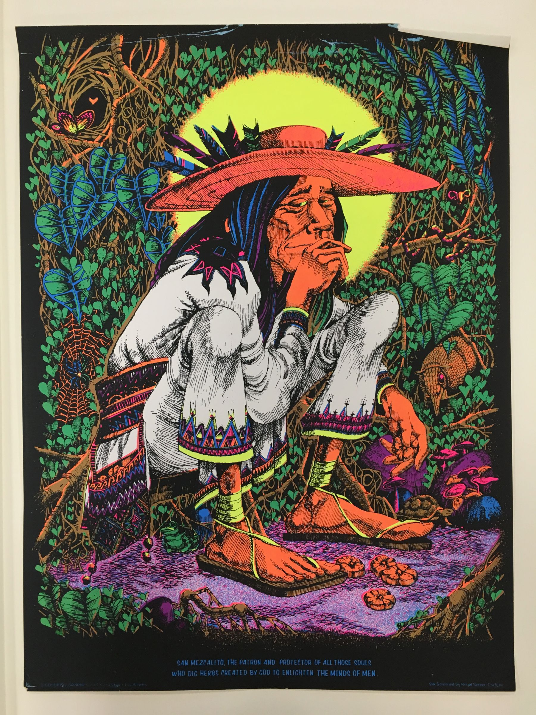 San Mezcalito, the patron and protector of all those souls who dig herbs created by god to enlighten the minds of men. Silk screen by Royal Screen Craft Inc., Cocorico Graphics, artwork by Rick Griffin : blacklight poster, undated
