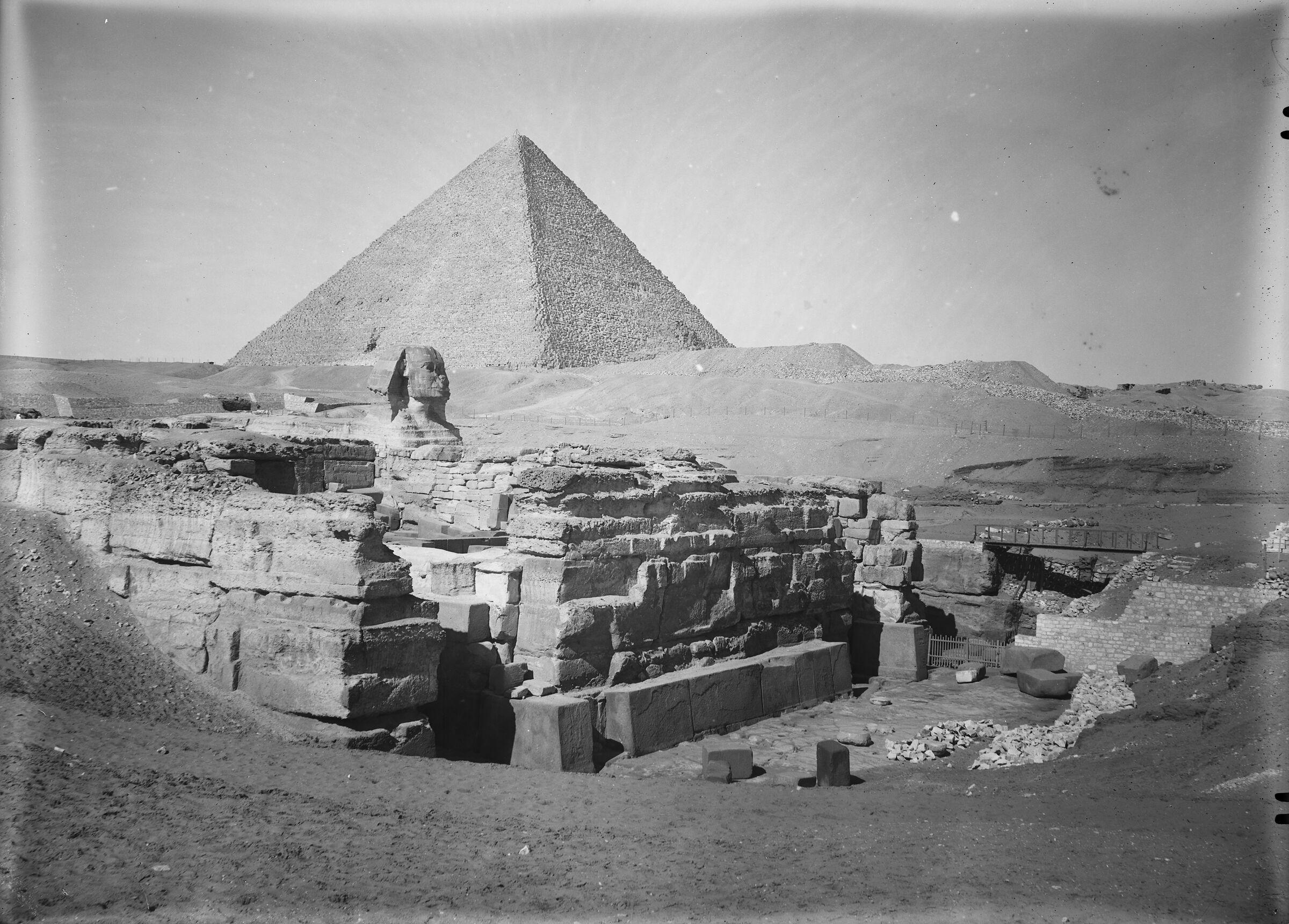 Sphinx Complex: Site: Giza; View: Sphinx, Khufu pyramid
